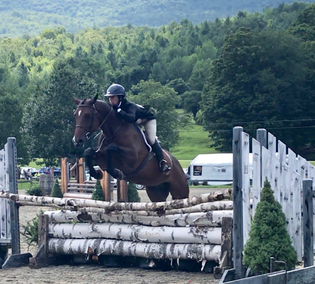 Megan Piermarini riding Ellie Crate's Castle at Vermont Summer Festival, 2018.